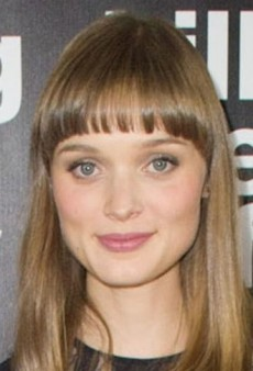 Look of the Day: Bella Heathcote Goes For High Drama in Black Elie Saab Gown