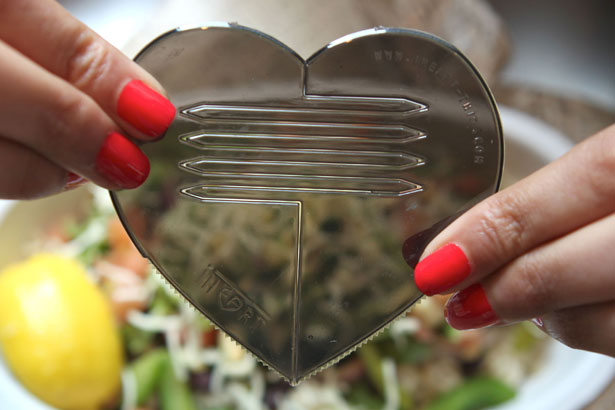 The biodegradable Heart Part: a heart-shaped utensil that  breaks open to reveal two forks, two knives and two scoops