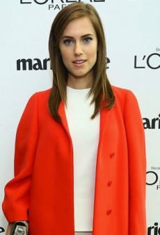 Allison Williams Covers Up Her White Calvin Klein Outfit with a Bright Orange Coat