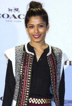 Freida-Pinto-Coach-New-York-Boutique-Opening-Madrid-portrait-cropped