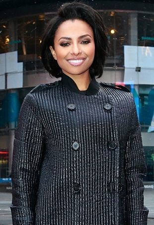Kat-Graham-rings-the-closing-bell-at-NASDAQ-MarketSite-New-York-City-portrait-cropped