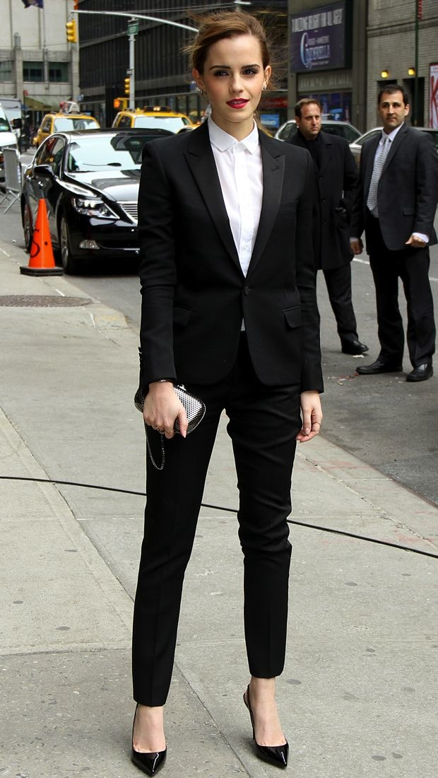 Emma Watson posing on a street in New York in a Yves Saint Laurent fitted tux and pumps