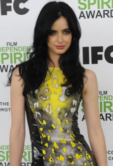 Krysten Ritter Strikes a Fierce Pose in Versace's Fall 2013 Animal Print Dress