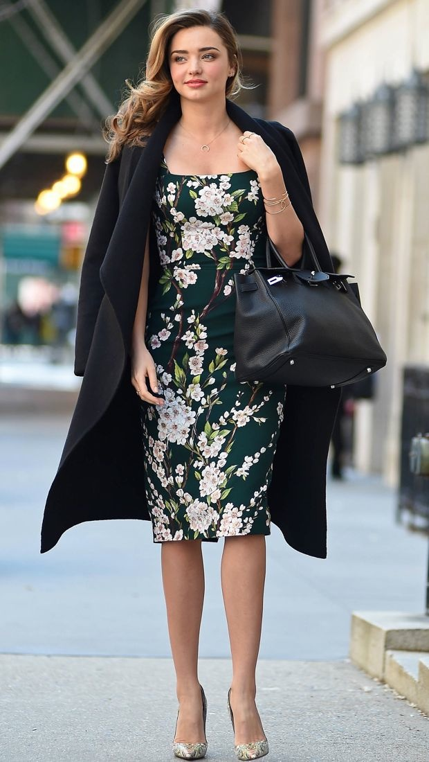 Miranda Kerr in a green floral Dolce Gabana dress, Christian Louboutin shoes with a black coat and hermes birkin