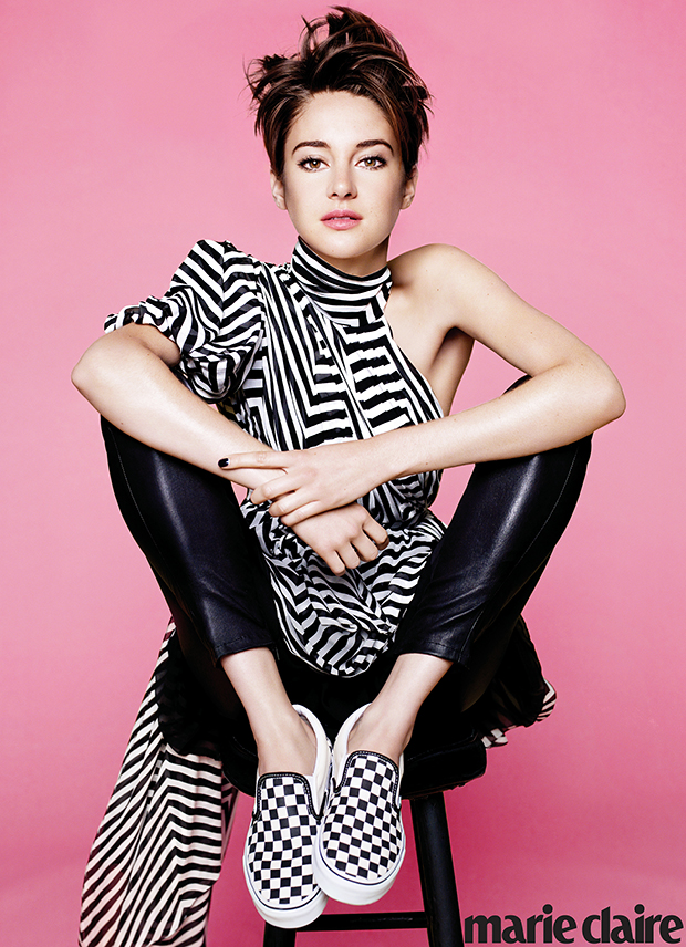 Shailene Woodley in a black and white outfit on a pink backdrop