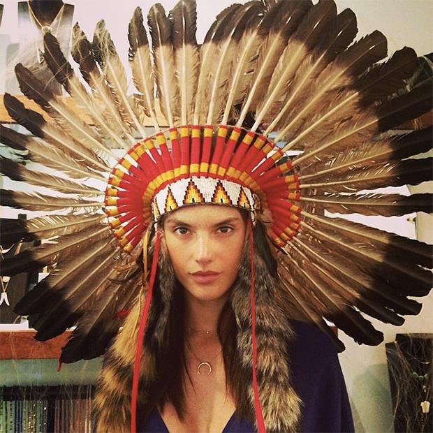 Alessandra Ambrosio wearing a Native American headdress