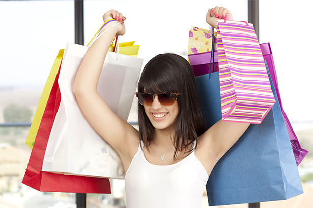 young woman shopping with bags smiling
