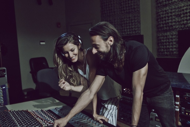 Gisele with French music producer and DJ Bob Sinclar for H&M campaign