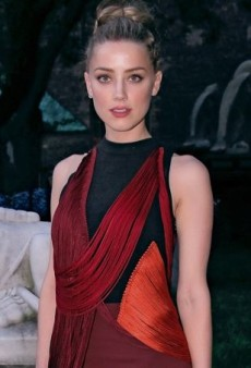 Amber Heard Attends Stella McCartney's Resort 2015 Presentation in a Fall 2014 Silk Cord Dress