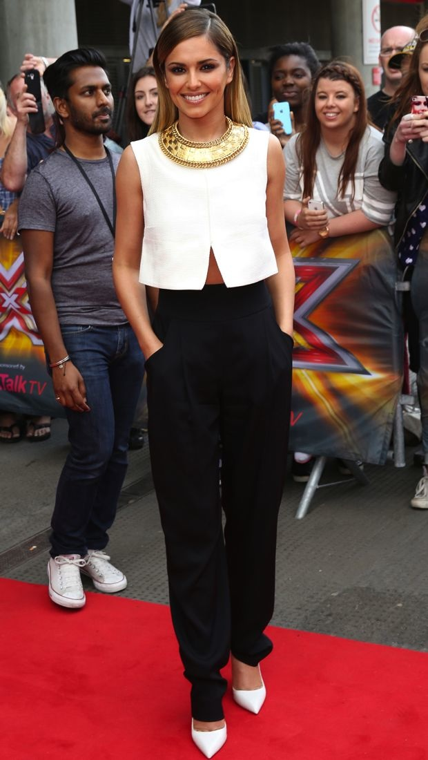 Cheryl Cole pairs a white Jil Sander top with black Temperley London pants and a gold Balmain necklace