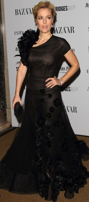 Gillian Anderson in a black sheer Nicholas Oakwell Couture gown