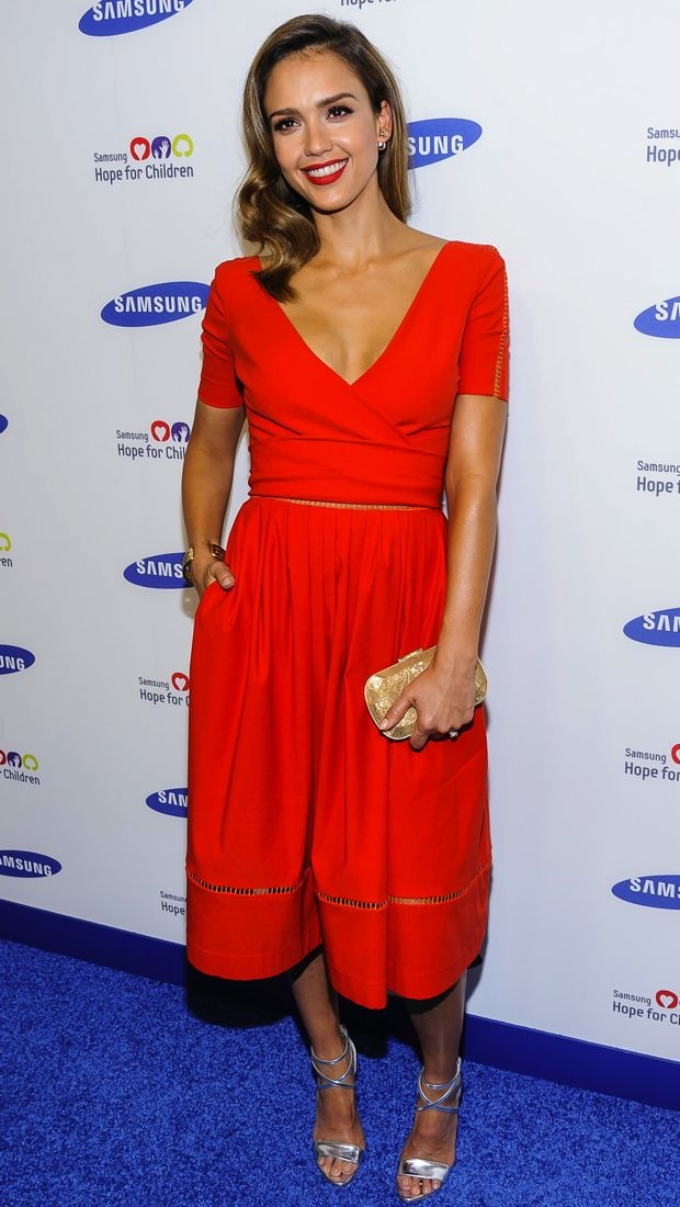 Jessica Alba wears a red hot Preen Fall 2014 dress