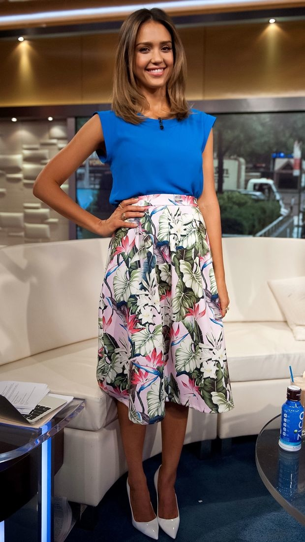 Jessica Alba looked summer-ready in a blue top and tropical print Topshop skirt