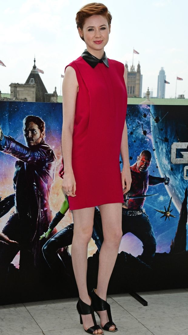 Karen Gillan poses for a photocall in a Gucci dress