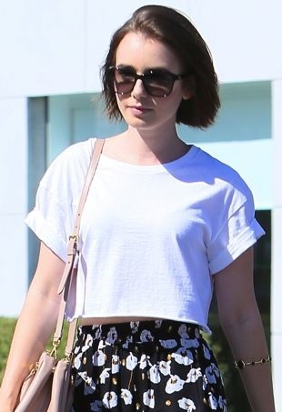 Lily-Collins-leaves-the-Andy-Lecompte-Salon-Los-Angeles-portrait-cropped