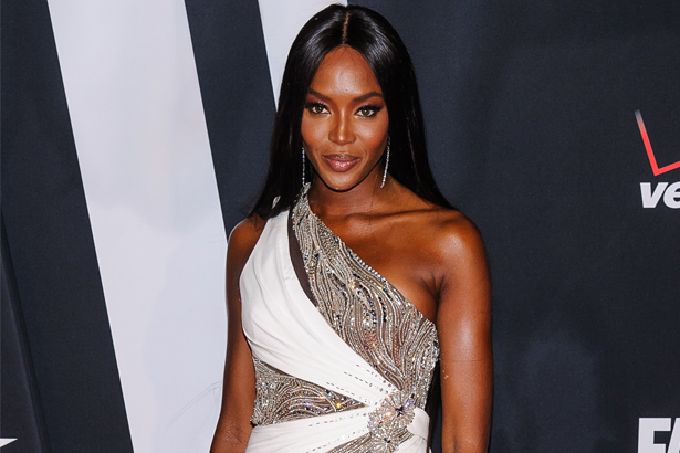 Naomi Campbell in a offshoulder white and silver dress