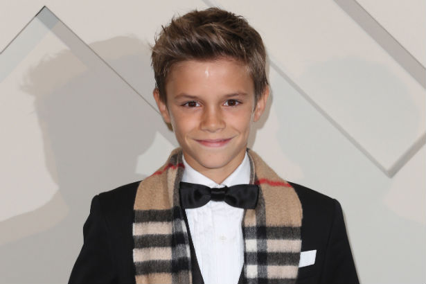 Romeo Beckham in a tux with burberry scarf