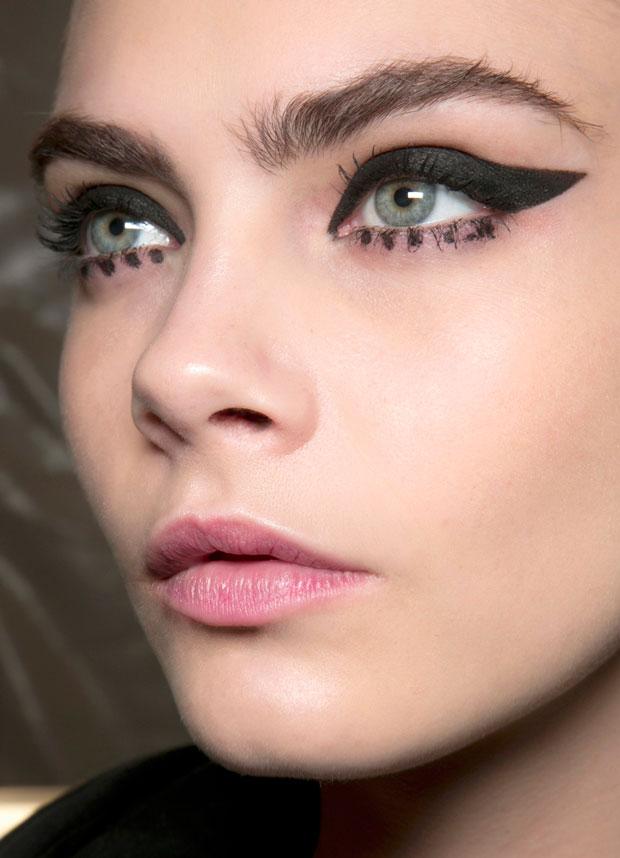 Cara Delevigne wearing thick, winged eyeliner