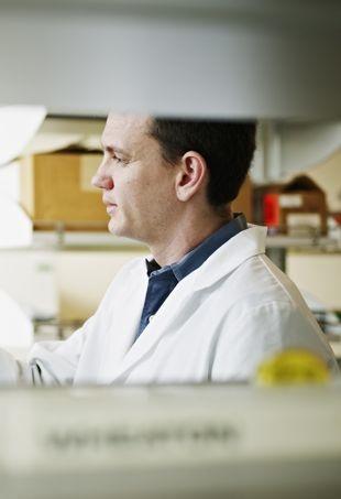 Researcher-inlab-holdingvile-portraitcropped