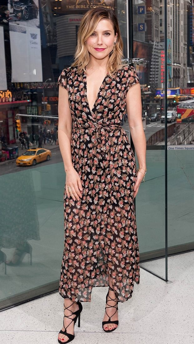 Sophia Bush wears a floral-covered Reformation dress on