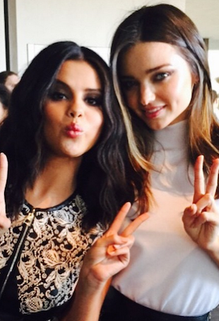 Selena Gomez and Miranda Kerr pose at the Louis Viuttion Cruise show