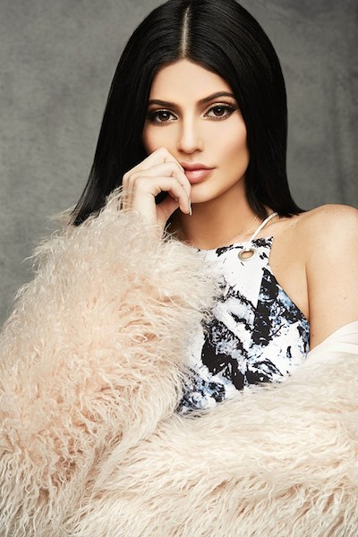 Kylie Jenner wears Topshop Holiday collection white fur coat