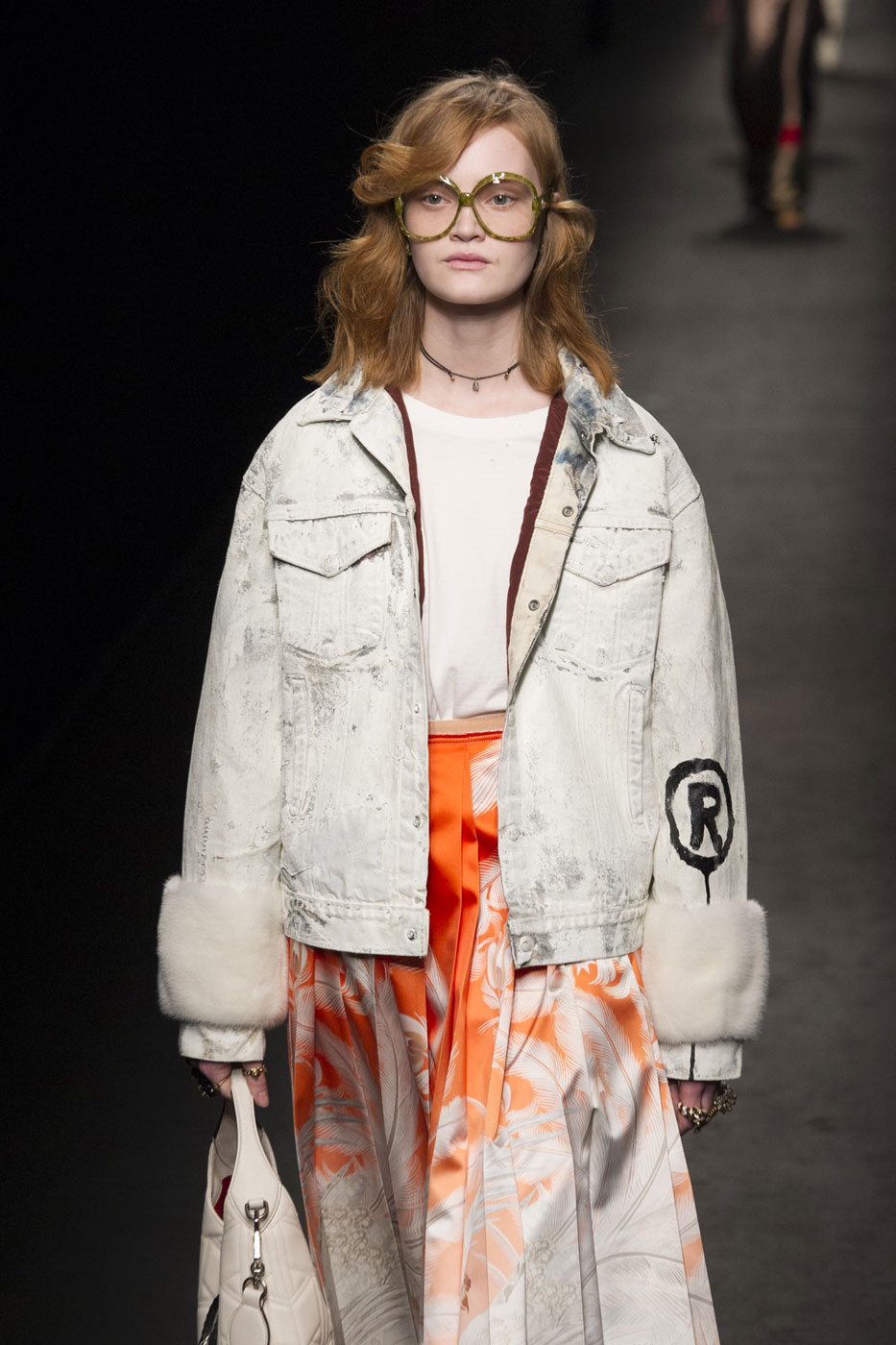 A model (who looks remarkably like Barb from Netflix's 'Stranger Things,' no?) rocks painted denim on the Gucci Fall 2016 runway.