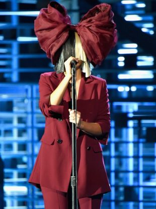 "LOS ANGELES, CA - NOVEMBER 18: Recording artist Sia performs onstage at A+E Networks ""Shining A Light"" concert at The Shrine Auditorium on November 18, 2015 in Los Angeles, California. (Photo by Kevin Mazur/Getty Images for A+E Networks)"