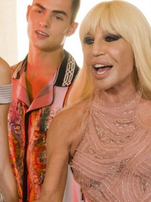 "Donatella Versace pays tribute to her friend Bruno Mars in a new music video set to the singer's hit single ""Versace on the Floor."" It's pretty fun."