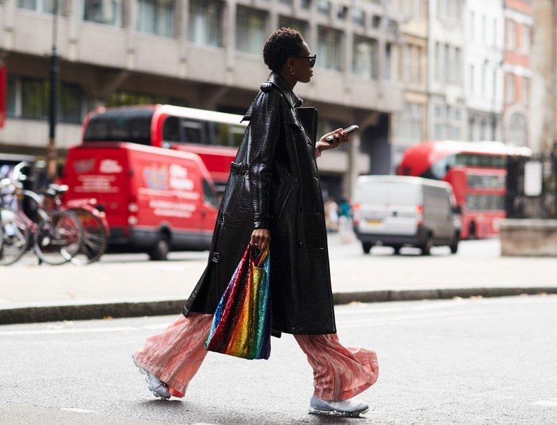 woman wearing vinyl trench coat, street style