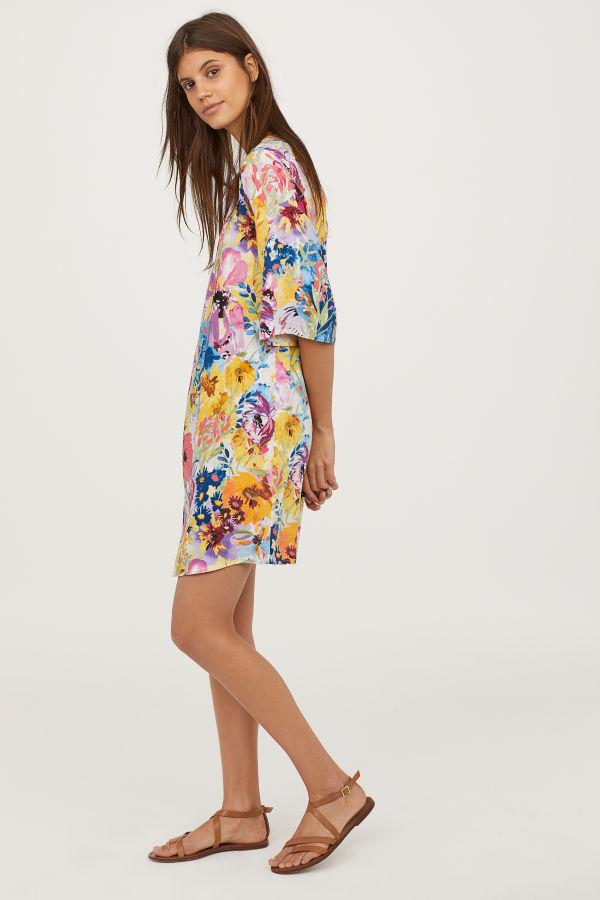 H&M  25 Statement-Making Spring Dresses Under $100 HM Trumpet Sleeve Dress