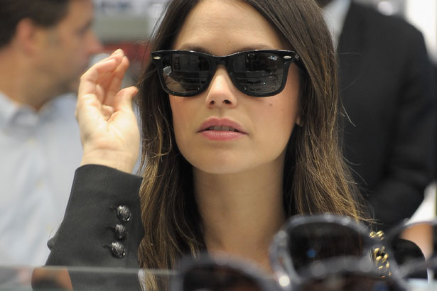 Rachel Bilson tries on sunglasses, image via Charley Gallay/Getty Images