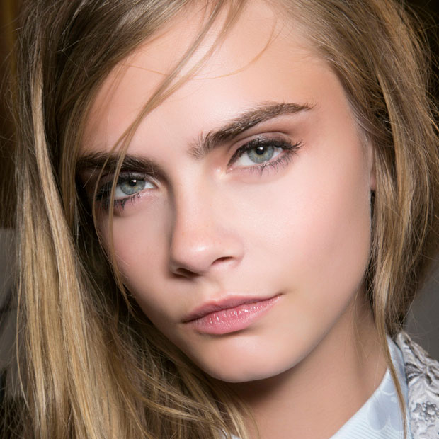 Cara Delevigne shot close up to emphasize her brows