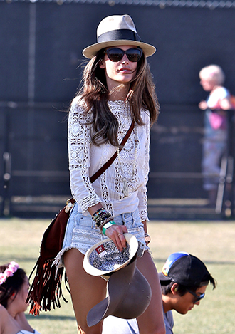 Alessandra Ambrosio in oversized sunglasses and crochet top at Coachella