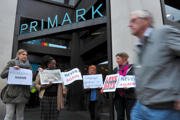 People protesting outside of a Primark store