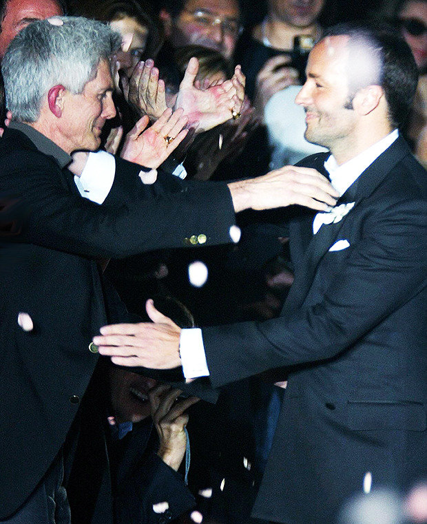 Richard Buckley and Tom Ford embrace at a 2004 Gucci Show