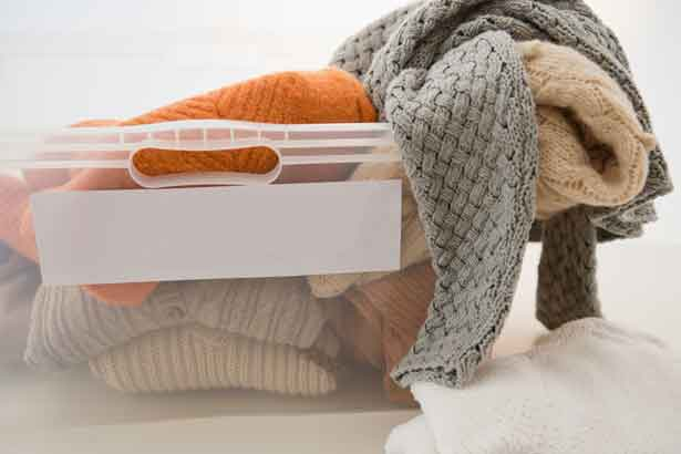 sweaters in a storage box