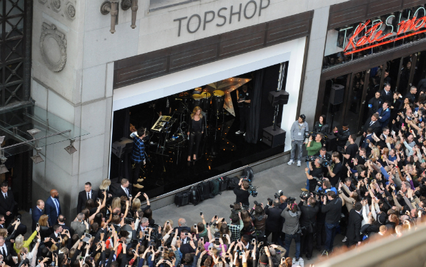 Kate Moss greets the crowds in front of Topshop's flagship store in Oxford Street