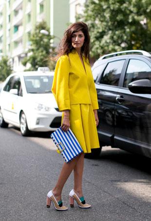 Street style star wears bright yellow