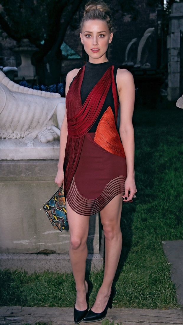 Amber Heard bravely sports one of Stella McCartney's Fall 2014 candy-centric dresses