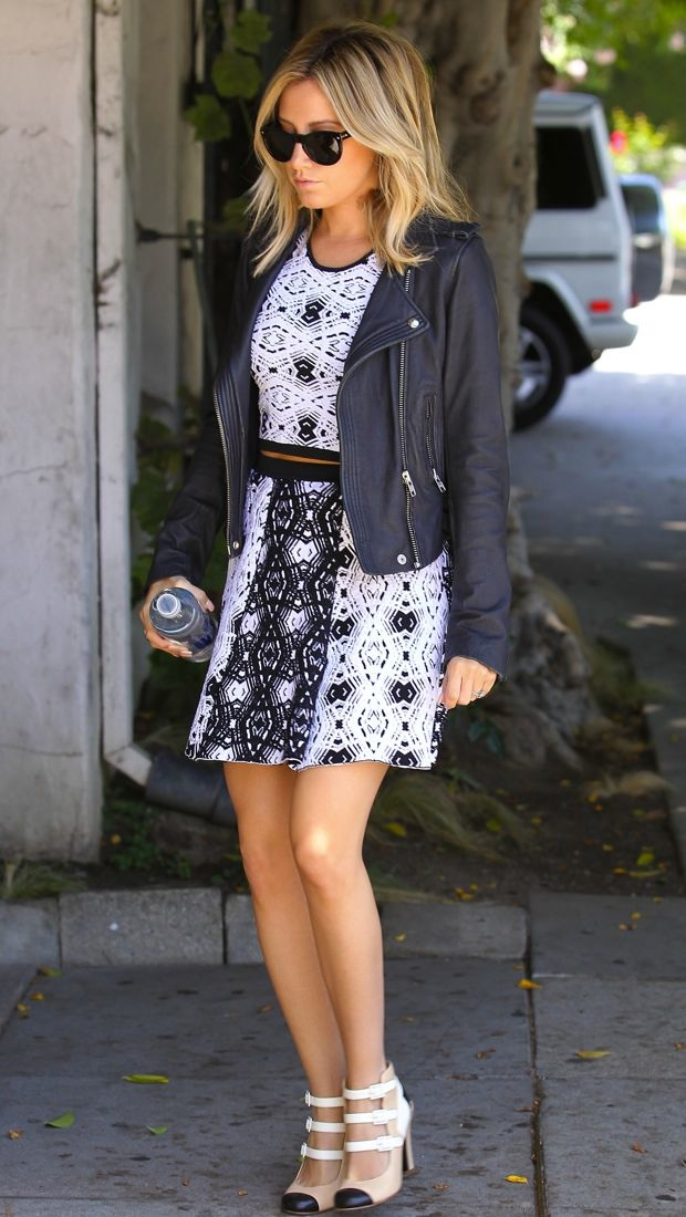 Ashley Tisdale tops off her Parker crop top and flared skirt with an IRO black leather jacket