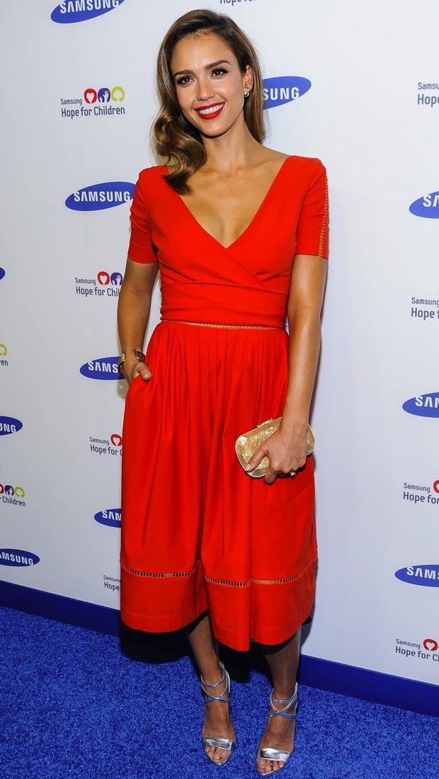 Jessica Alba wears a red hot Preen Fall 2014 dress
