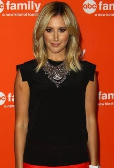 Ashley Tisdale Artfully Accents Her Black AllSaints Top and Orange Mason by Michelle Mason Skirt