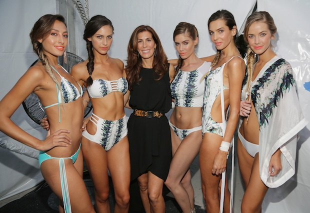 Designer Kirsten Sarkisian poses backstage with her models at the Belusso show during Mercedes-Benz Fashion Week Swim 2015; Image: Getty