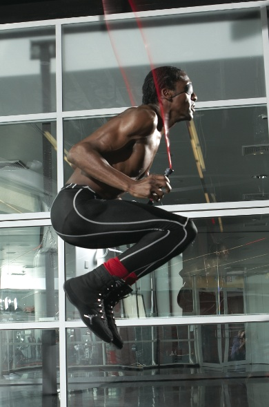 Michael Olajide jumping rope in his gym