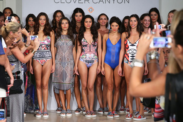 Models pose on the runway after the Clover Canyon presentation 2015