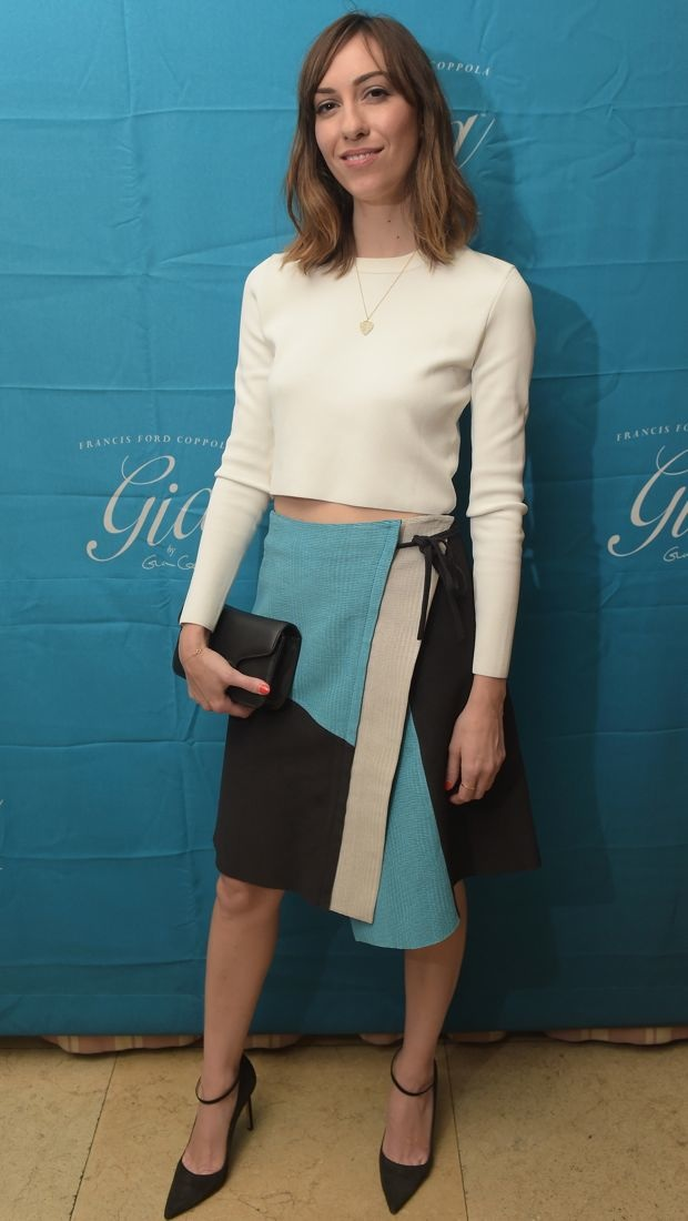 Gia Coppola wears a creamy crop and a colorblock skirt to a wine launch