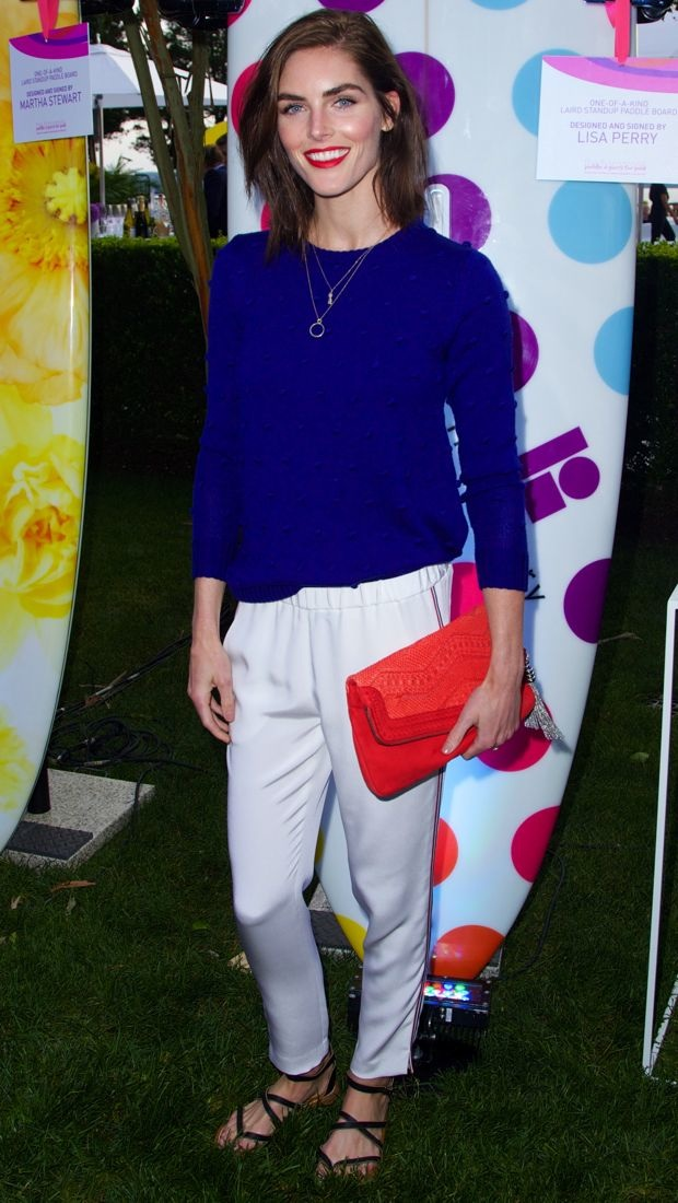 Hilary Rhoda wears a blue Lisa Perry sweater and white pants to a fundraiser