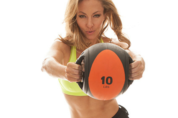 Fitness instructor Loren Bassett does ab workout with 10 lb ball