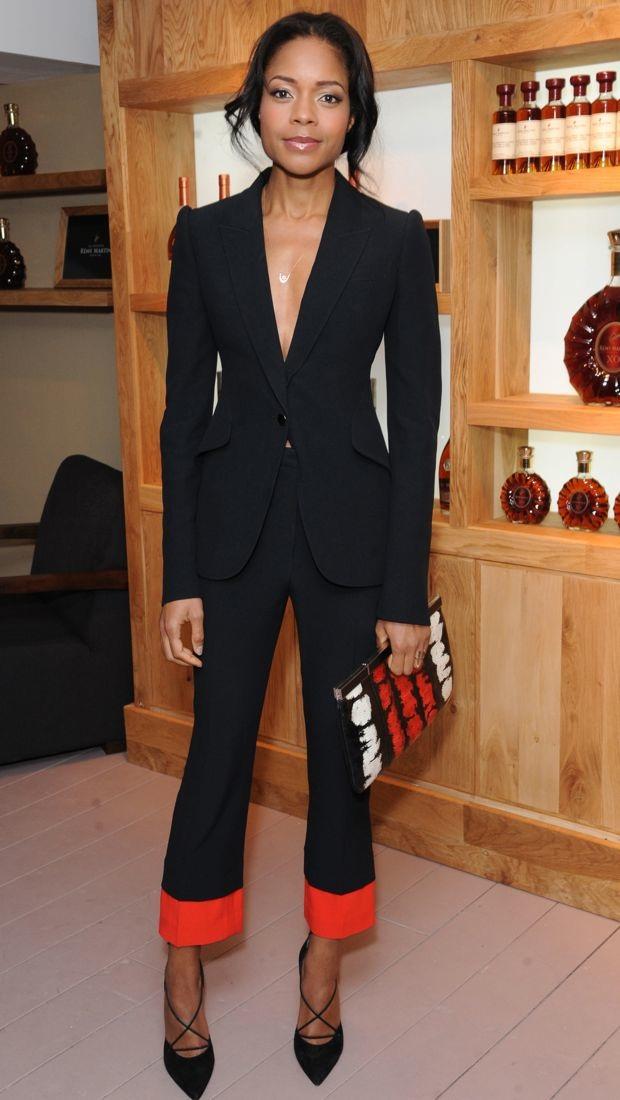 Naomie Harris wears a black Alexander McQueen suit